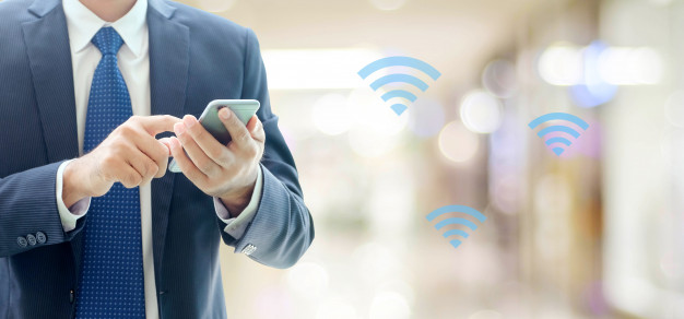 business-man-hands-using-smart-phone-with-wifi-icon-over-blur-office-background-businessman-on-phone_7190-547.jpg